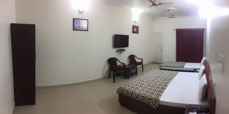 bedroom of hotel landmark dudhwa - Hotels in Palia - Hotels Near Dudhwa National Park